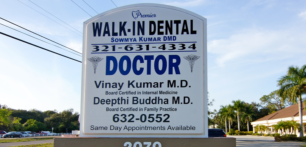 Premier Walk-In Dental road sign