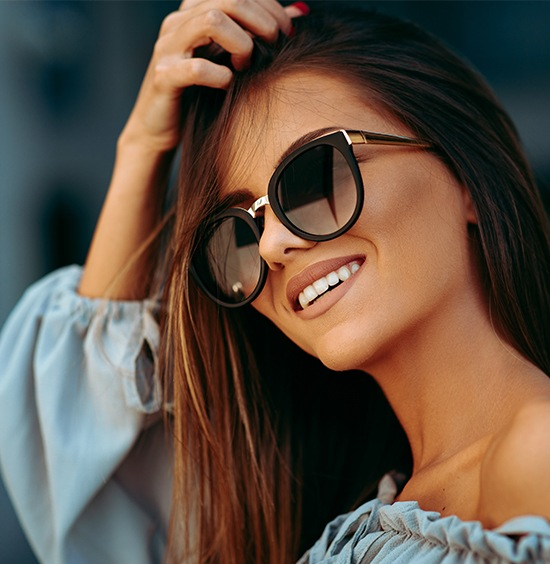 beautiful woman with veneers smiling