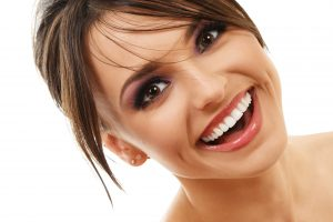 woman smiling with perfectly white teeth